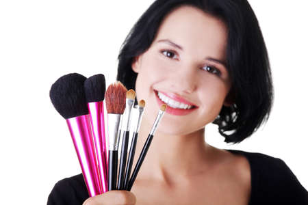 Young make-up artist woman holding brushes  photo