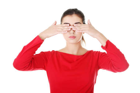 Young teen woman covering her eyes  photo