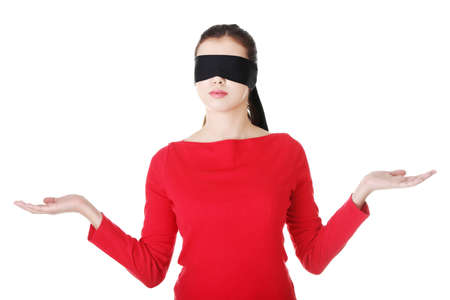 Blindfold woman presenting copy space on her palms, isolated on white  photo