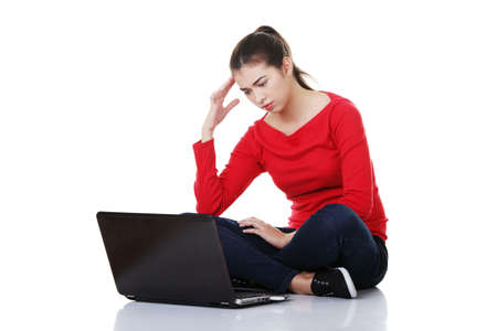 pornography: Sad woman looking on laptop screen. Isolated on white.