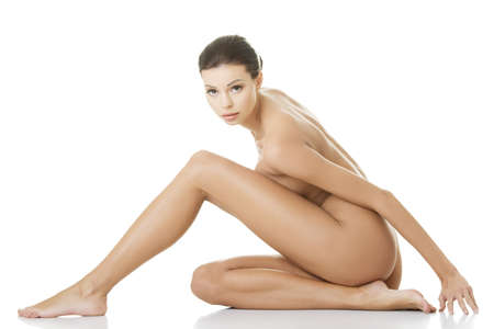 beautiful nude woman: Sexy fit naked woman with healthy clean skin, isolated on white background  Stock Photo