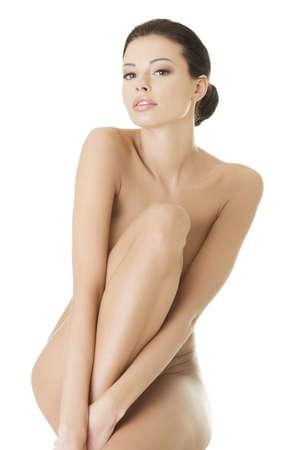 Sexy fit nackte Frau mit gesunden saubere Haut, isoliert auf wei�em Hintergrund