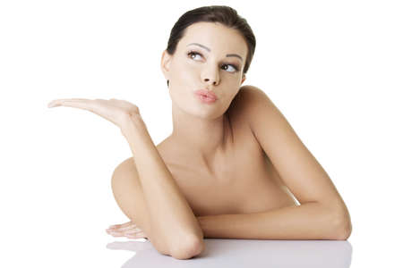Attractive woman with clean fresh skin presenting copy space on her palm Stock Photo - 16917696
