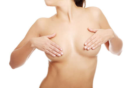 anatomy naked woman: Breast cancer concept - Woman holding her breast  Stock Photo
