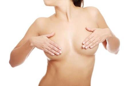 mujer desnuda senos: Concepto de c�ncer de mama - mujer sosteniendo su pecho Foto de archivo