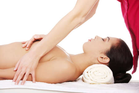 breast beauty: Beauty young woman relaxing in spa. Breast massage.