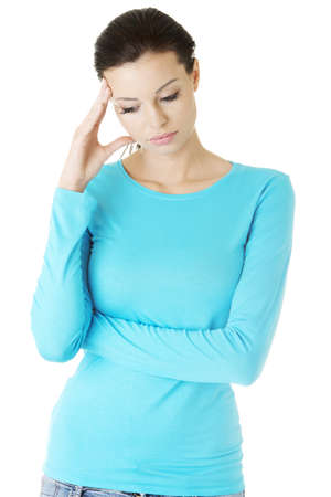 Young sad woman have big problem ,depression or headache , over white background  photo