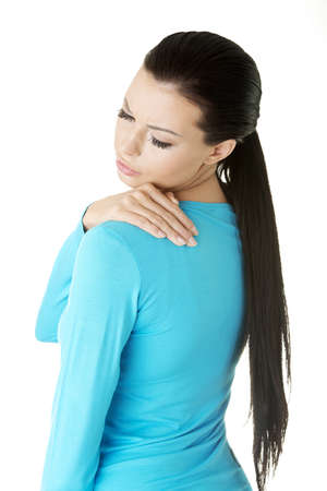 Young woman with backache, isolated on white  photo