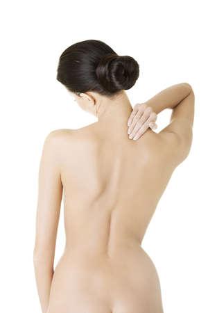 back of woman: Mujer joven con dolor de espalda. Aislado sobre fondo blanco.