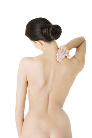 woman back: Young woman with pain in her back. Isolated on white background.