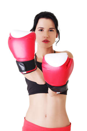 Boxing fitness woman wearing red boxing gloves. Isolated on white. photo