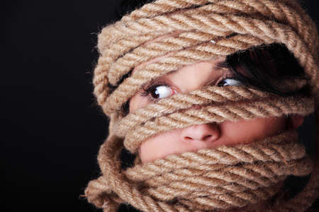 bound woman: Tied up scared woman face. Violence concept.