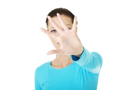 Hold on, Stop gesture showed by young woman hand  Stock Photo - 17600428