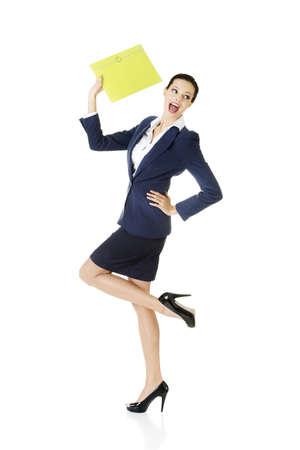 Full portrait of attractive happy businesswoman holding portfolio, isolated on white photo