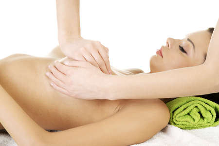breast sexy: Beauty young woman relaxing in spa. Breast massage.