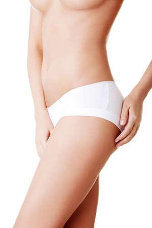 Красивые женского тела, изолированных на белом. Сексуальная молодая женщина в белых трусиках Фото со стока