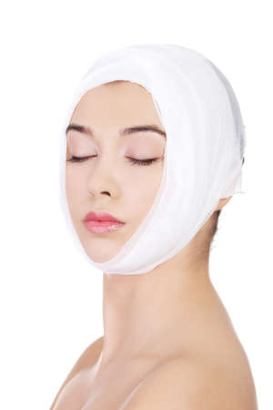 plastic wrap: Portrait of beautiful young female face with bandage - beauty treatment plastic surgery