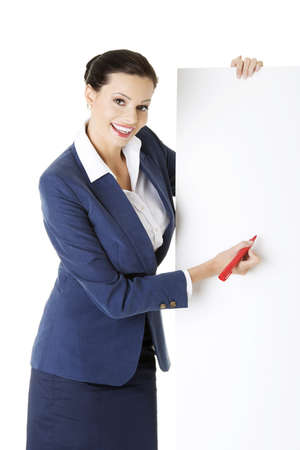 Attractive businesswoman holding blank board and writing on it with marker. Isolated on white  photo