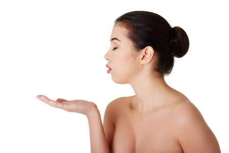 Attractive woman with clean fresh skin presenting copy space on her palm  Stock Photo - 18185548