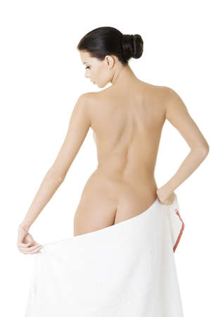 Young beautiful nude woman after bath or spa with towel , isolated on white