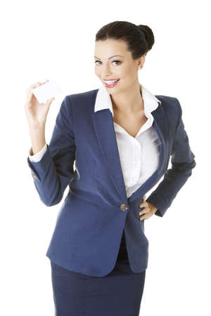 businesscard: Beautiful smiling businesswoman with businesscard  Isolated on white  Stock Photo
