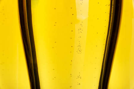 Beer in glass close up photo