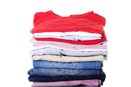 dirty clothes: Stack of clothing isolated on white