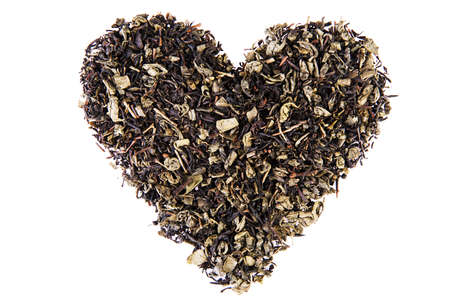theine: Heart shape from tea leaves Stock Photo