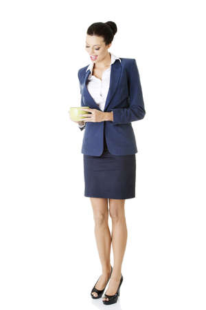 Business woman with big mug - break time photo