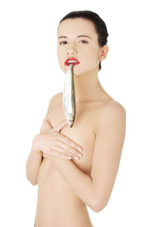 Beautiful young naked woman with fish in her mouth  photo