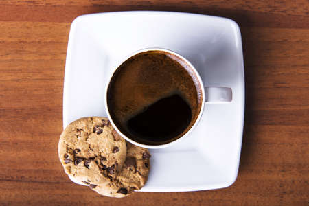 Coffee with cookie on table photo