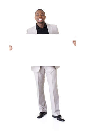 blank banner: Happy successful businessman holding and showing blank advertisement. Isolated on white.