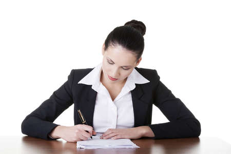 undersign: Beautiful attractive corporate lawyer business woman sitting at desk and writing blank paper page, isolated on white background.
