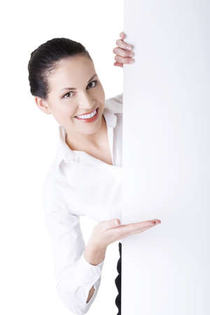 Smiling young business woman showing blank signboard, over white background isolated 版權商用圖片 - 22466018