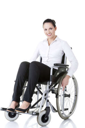 Attractive smiling disabled businesswoman sitting in a wheel chair isolated on white  photo