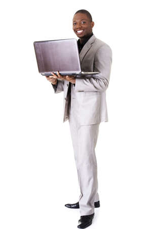 Happy businessman with laptop. Isolated on white  photo