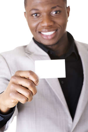 Businessman with blank business card, isolated on white photo