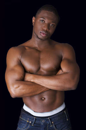 nude man: Muscular black man, against black background Stock Photo