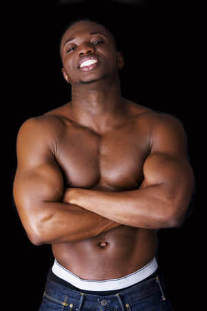 afro american nude: Muscular black man, against black background Stock Photo