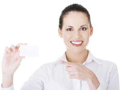 businesscard: Beautiful smiling businesswoman with businesscard. Isolated on white