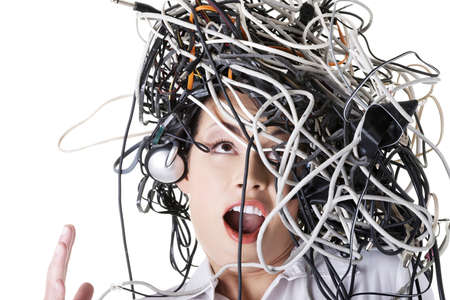 Troubled shocked businesswoman with cables on head  photo