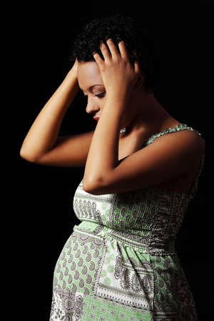 black pregnant woman: Depression and stress of young pregnant woman against black background