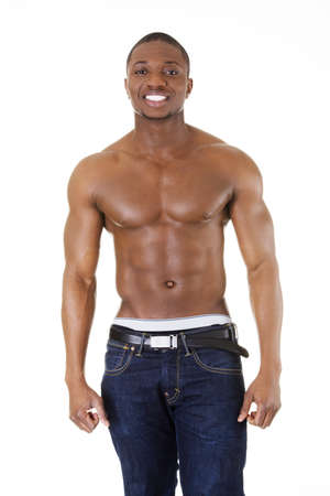 Happy well-built muscular black man in jeans, isolated on white photo