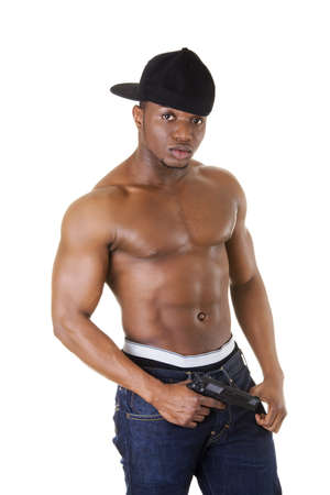 Afro american man standing with gun in hand. Thug and gangsta concept. photo