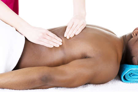back massage: Masseur doing massage on man body in the spa salon. Stock Photo