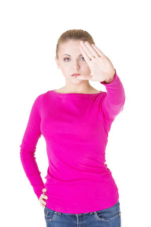 showed: Hold on, Stop gesture showed by young woman hand