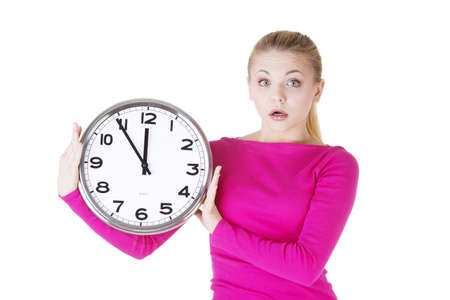 Portrait of shocked woman with clock over white background  Stock Photo