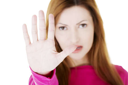 showed: Hold on, Stop gesture showed by adult woman hand