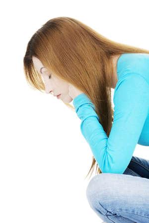 stressed people: Sad depressed woman portrait, over white background