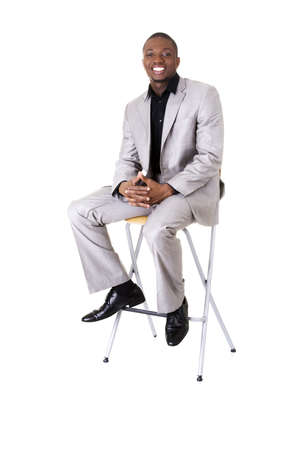 siting: Happy smart black businessman smiling, isolated on white.